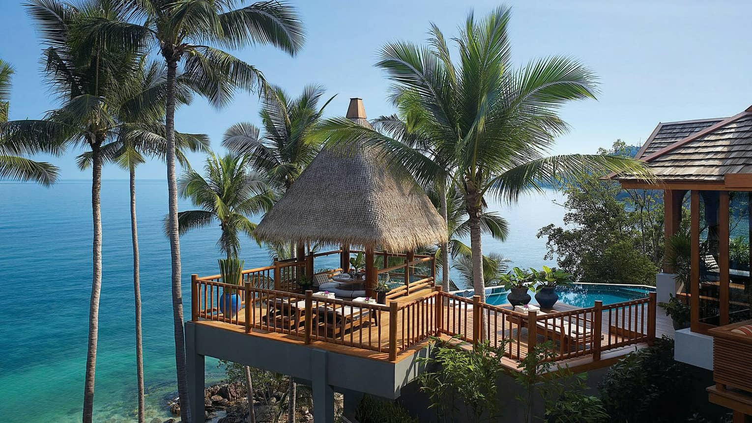 Two-Bedroom Residence Villa with Pool patio with thatched roof cabana on mountain high above trees, ocean