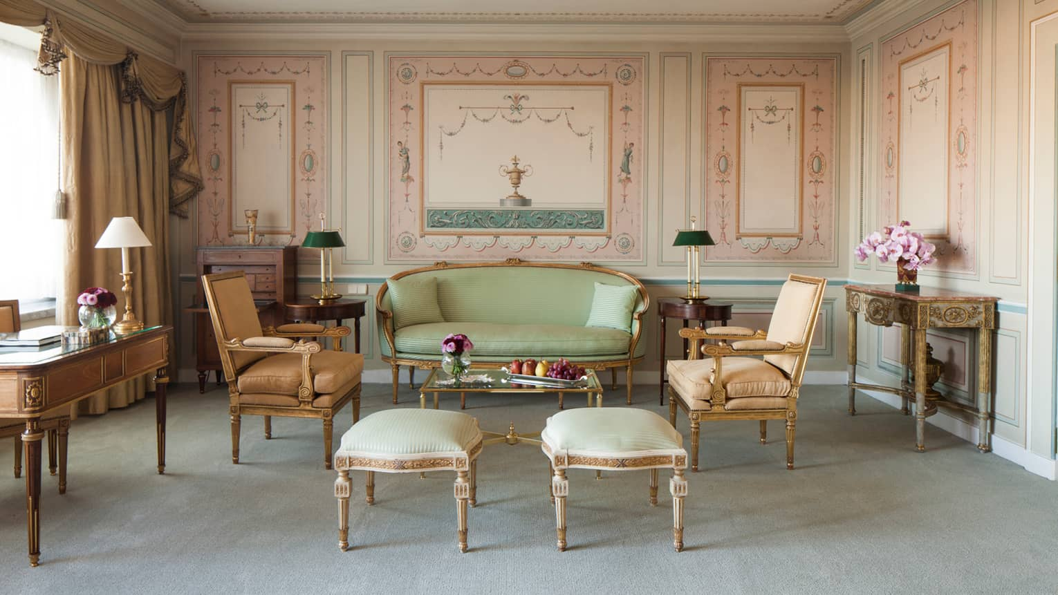 Foundation Suite living room with painted antique-style wall panels, antique furniture with gold trim