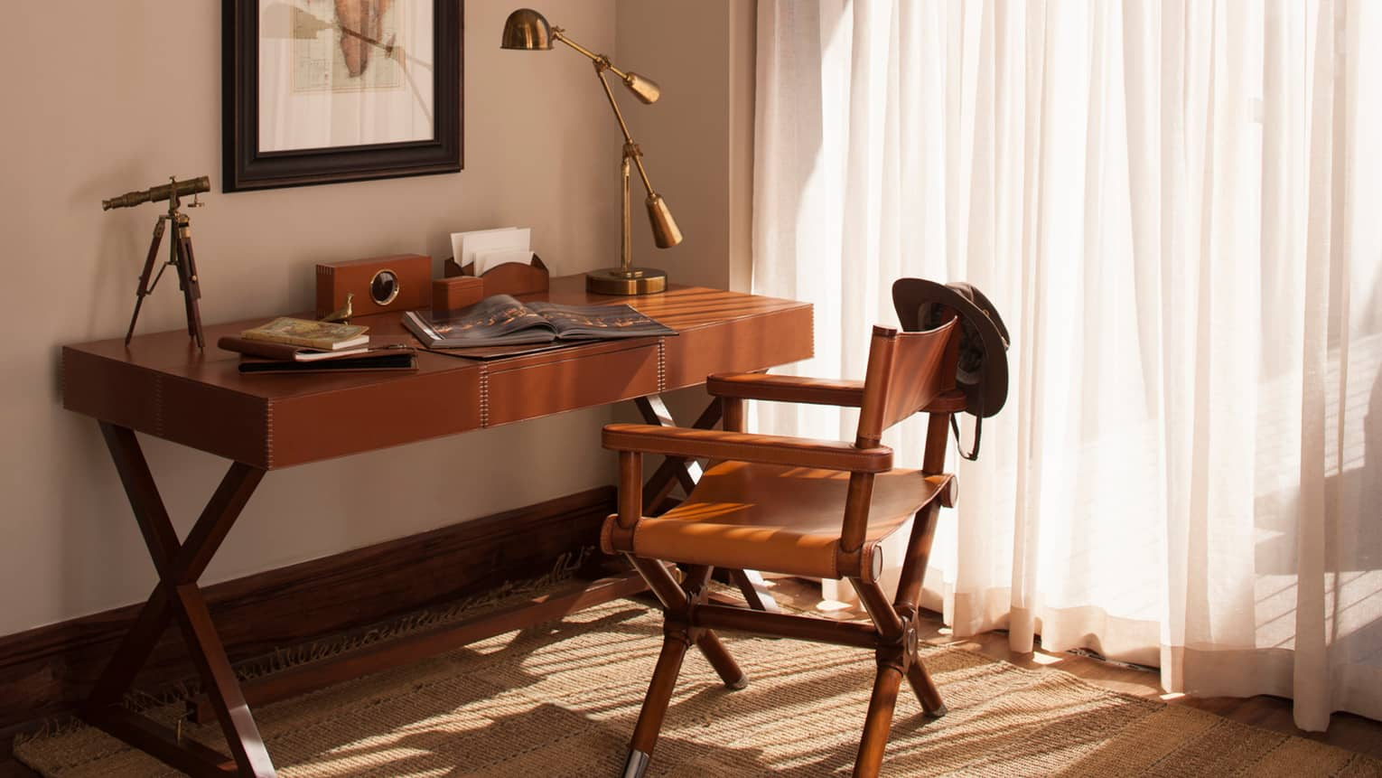 Presidential Villa wood desk with open magazine, brass lamp and telescope, leather chair