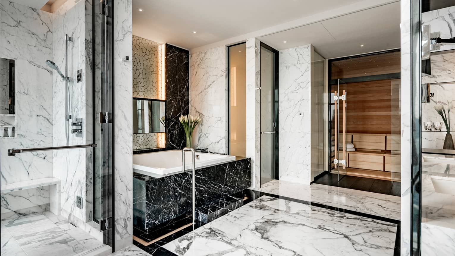 Presidential Suite full marble bathroom with white marble glass walk-in shower, black marble tub