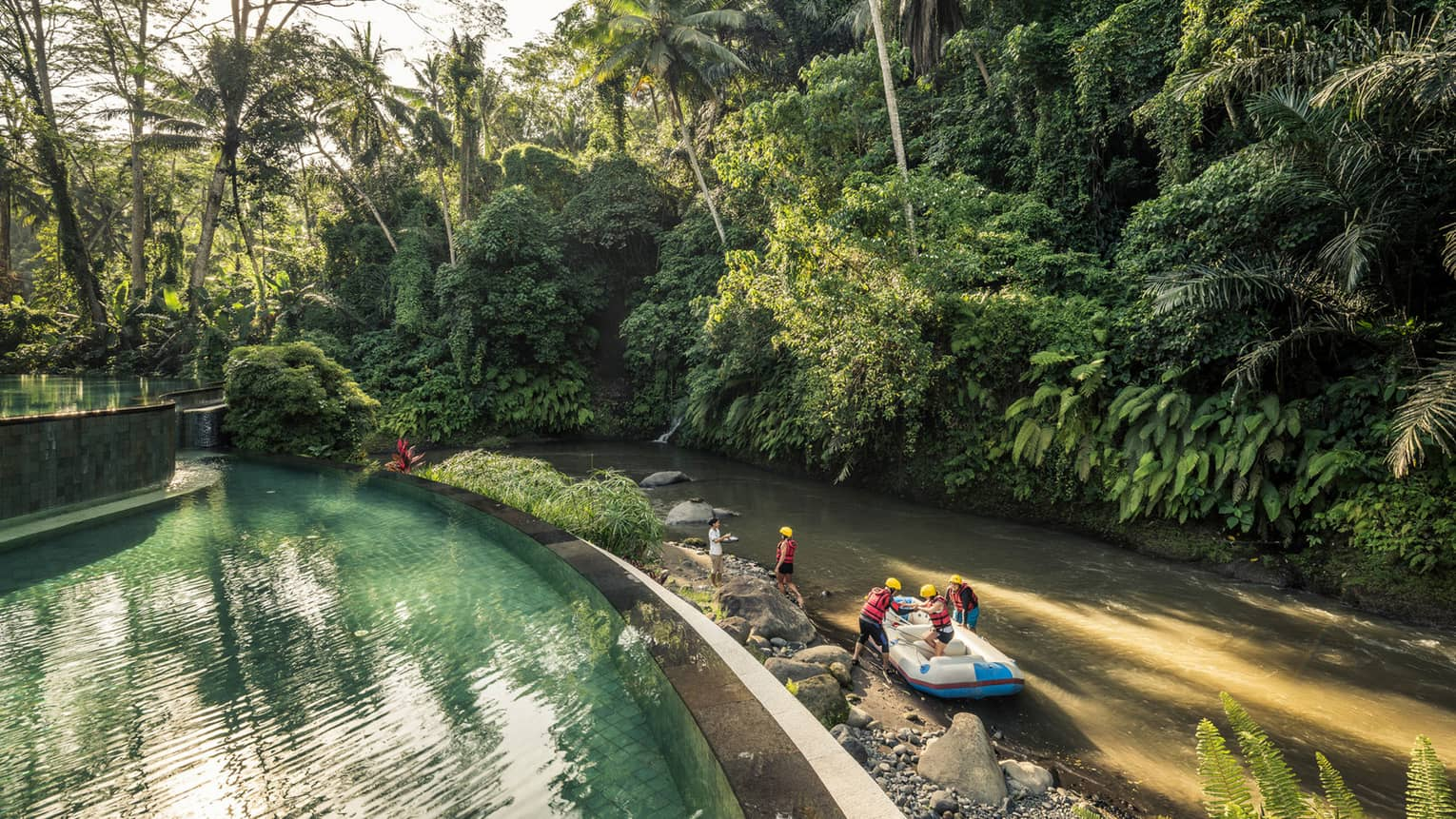 An aerial view of four seasons guests arriving to the sister Bali Resort in a raft \
