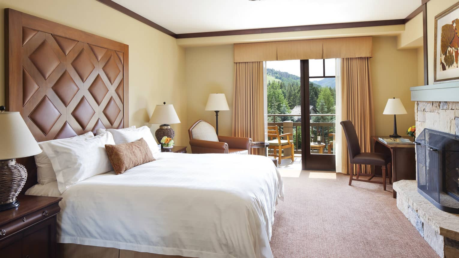 Sunny Mountain-View Room with bed, tall wood-and-leather headboard, open balcony door
