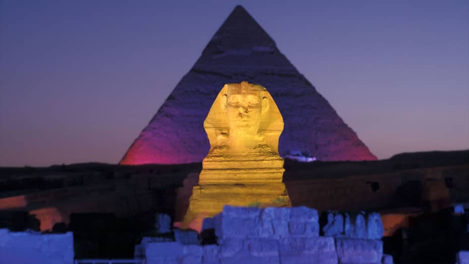 Night view of Pyramids of Giza and Great Sphinx illuminated